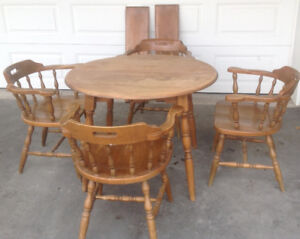 Solid maple round table and chairs.