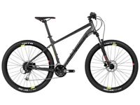 Norco 7.1 2017 mountain bike with helmet