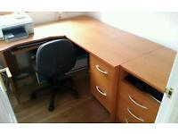 Wood effect office furniture with chair.