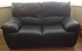 Sofa, black leather, two seater, perfect condition, only selling to convent room into a playroom.