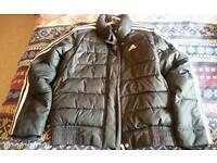 Black Adidas puffa jacket. Age 9-10yrs.