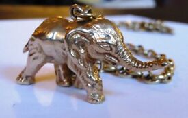 9ct gold elephant and chain.