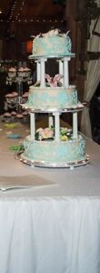 Three tier wedding cake and a topper