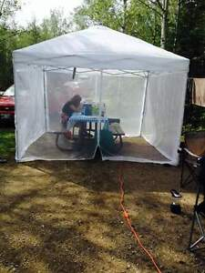 camping or outdoors solar lighted screened gazebo
