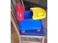 Infant booster seat with table