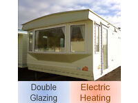 Static caravan 28 x 12 ft 2 bedrooms, double glazing and electric heating