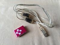 MP3 PLAYER WITH LARGE MEMORY CAPACITY, STORES OVER 2000 SONGS. CABLE ALSO INCLUDED