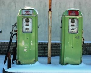 We will buy porcelain and tin signs, gas pumps ,