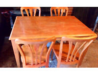 BEAUTIFUL SOLID WOOD DINING TABLE AND 4 CHAIRS 48 INCHES X 30 INCHES VERY STRONG AND STURDY