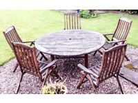 Solid used 66 inch wooden garden table with six chairs and parasol