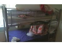 Bunk Bed (Single x2) with both mattresses - Used in Good Condition - Metal Body with Ladder - STRONG
