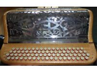 Fratelli Crosio French system C system button accordion. Double cassotto .