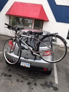 Kuwahara Road Bike with a  2 Bike Trunk Mount Carrier