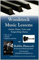 Learn the songs you love!  Acoustic guitar, piano and voice!