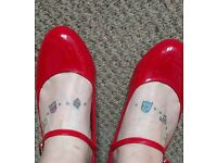 Red shiny Mary Jane low heels. Size 7 worn