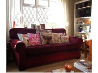 Very comfy burgundy sofa.
