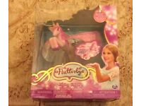 Flutterbye Flying Unicorn ( with charger). New,unopened in original packaging.