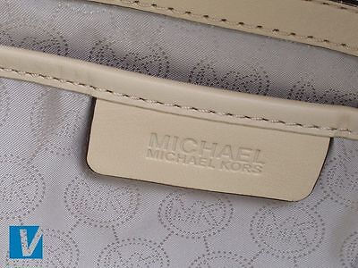 6c0d47906c97 The Michael Kors logo, in full or MK on the lining, may appear on the  interior of the handbag. Check the font, spacing and positioning of the  logo carefully ...