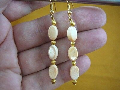 - EE-488-10) Rare tan ivory Helmet Shell 10x6x4 mm oval bead dangle gold earrings