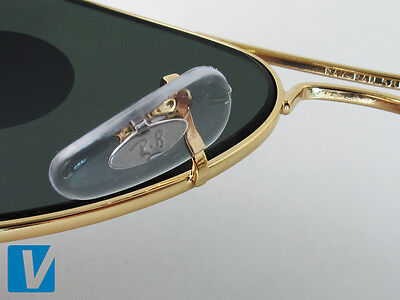 authentic ray ban aviator sunglasses  the word \ray ban\ followed by the size code are located on the underside of the metal nose bar. check that the code matches the size code detailed on
