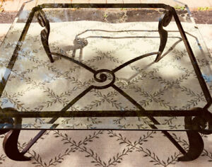 Coffee table with custom wrought iron base and beveled glass