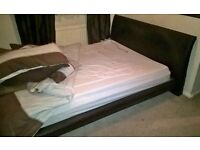 double bed, brown leather double bed with matress. 1 year old