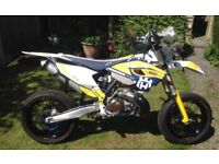 Husqvarna TE300 Supermoto/ Enduro. Only 720 miles and 21 hours use.