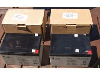 TWO YUCEL 12 VOLT 12 AMP RECHARGEABLE LEAD ACID BATTERIES - USED ONCE