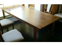 ikea dining table, large solid wood. 220cm x 90cm. In good condition.