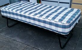 folding guest bed. length 177cm x 76cm. with quality spring mattress. In excellent condition.
