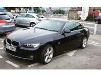 Black BMW 3 series. 2L convertible.