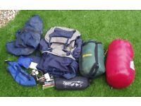 Rucksack & rolley mat, waterproof cover, protective flight cover, 2 sleeping bags & misc small items