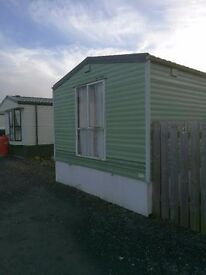 Static Caravan - two bedrooms,toilet and kitchen, living room and decking