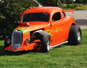 1938 Pymouth two door customized.