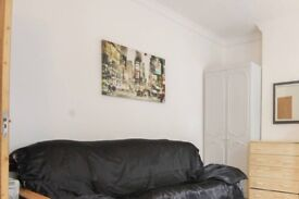 Spacious room with standalone wardrobe in 6-bedroom flat