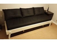 Wooden sofa bed, IKEA, transformed into a double bed with mattress.