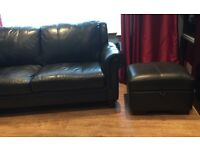 Black leather 3 seater sofa with single chair and storage stool . Traditional style