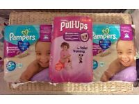 Pampers brand new/ sealed 5+ active fit (64 nappies) and pink Huggies pull ups in large