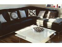 Faux leather black corner settee
