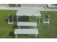 Camping folding table and stools.