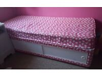 Girl's single bed with mattress and storage