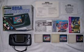Boxed sega game gear with games and instructions