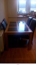 Dining table and 4 faux brown leather chairs