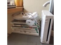 Nintendo wii and 4 games controller and nunchuck