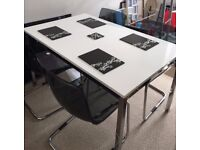 Modern white Ikea dining table with four chairs