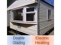 Static caravan, double glazed & electric heating, 32 x 12 ft / 2 bedrooms, only £4,995!