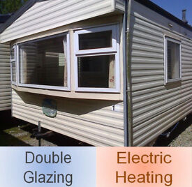 Static caravan, double glazing & electric heating, 32 x 12 ft / 2 bedrooms, only £4,995!