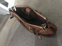 Genuine Michael Kors handbag.