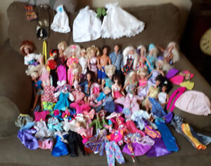 BARBIE DOLLS, AND CLOTHS...NEW PRICE.....