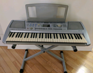 Yamaha electronic piano with stand